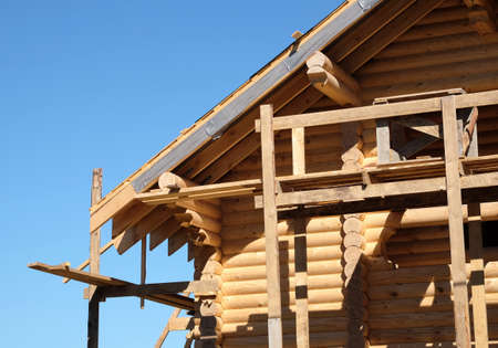 Process of a wooden house. Wooden country house construction