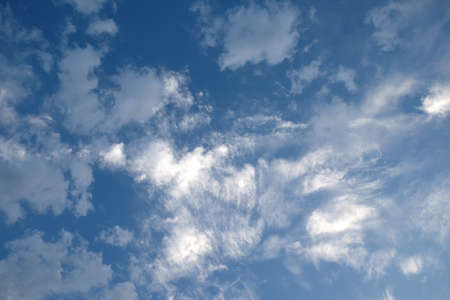 Beautiful sky background with white clouds high in the sky