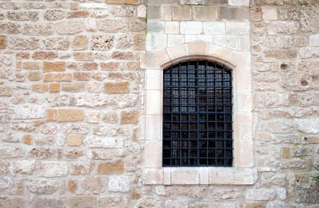 Wall from sandy limestone with window front view
