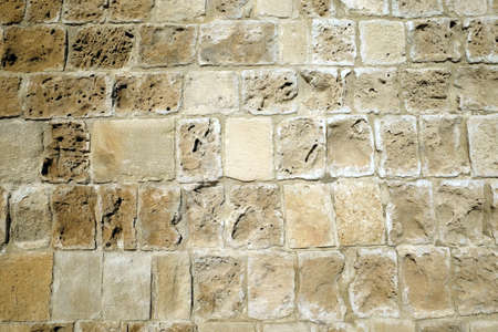 Ancien wall from limestone as background front view