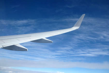 Passenger supersonic plane wing high in the sky