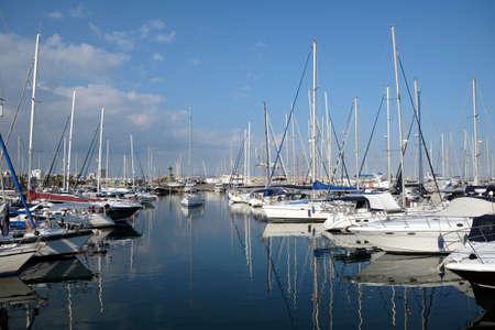Sea yacht parking in calm marina water