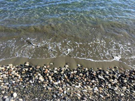 Seaside with clear sea waves near stone seacoast Banco de Imagens