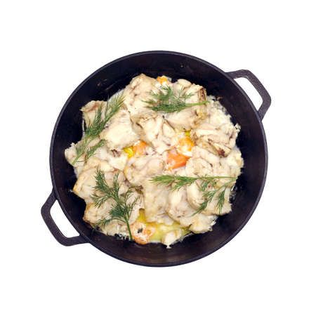Fried white fish fillet with carrot and dill on black pan Banco de Imagens