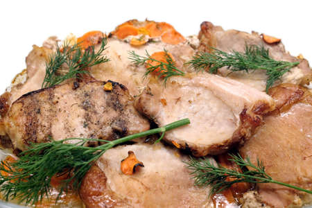 Appetizing fried pork meat pieces with carrot front view isolated Banco de Imagens