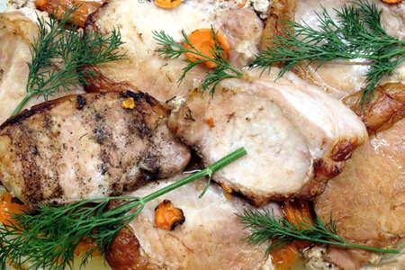 Appetizing fried pork meat pieces with carrot top view closeup Banco de Imagens