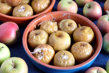 Still life with baked and raw apples closeup Banco de Imagens