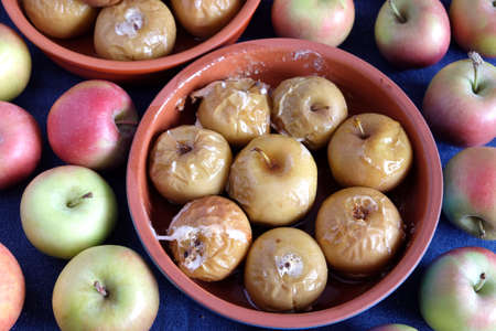 Many baked and raw apples top view closeup
