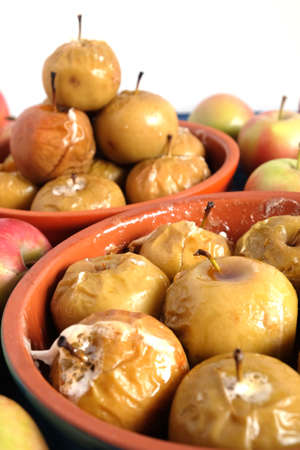 Lot of baked and raw apples studio shot isolated