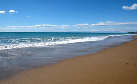 Seaside with long empty sandy beach Banco de Imagens
