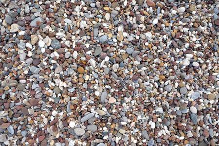 Beach stone pebble as background top view closeup Banco de Imagens