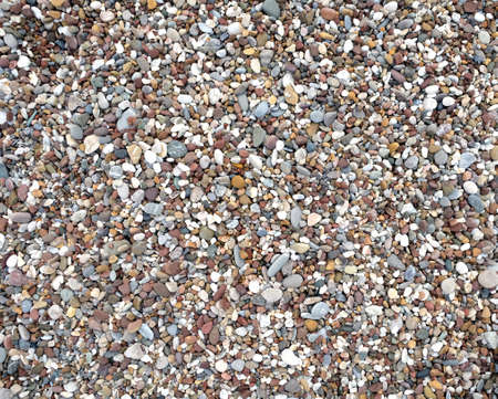 Many beach stone pebble as background top view closeup