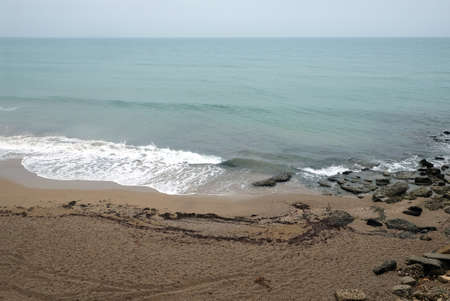 Empty beach and sea coast in overcast day