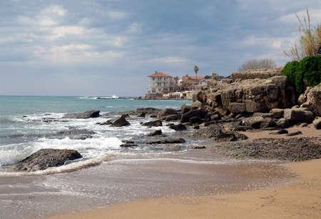 Alone house on the sea coastline in overcast day Banco de Imagens