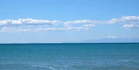 Panoramic seascape with mountains at far