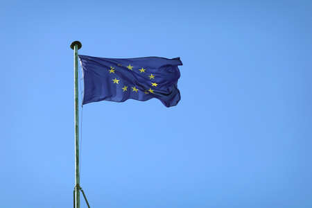 Flag of the European Union waving on sunny day