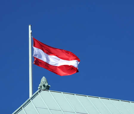 Austrian flag on top of the house