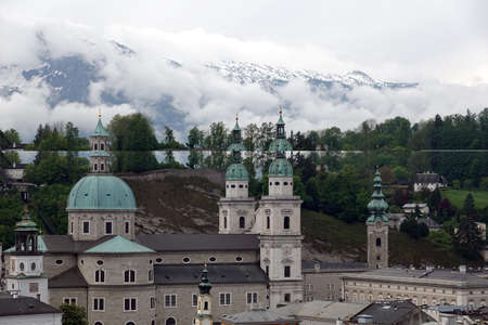 Old town of Salzburg view before high Alps mountains Banco de Imagens