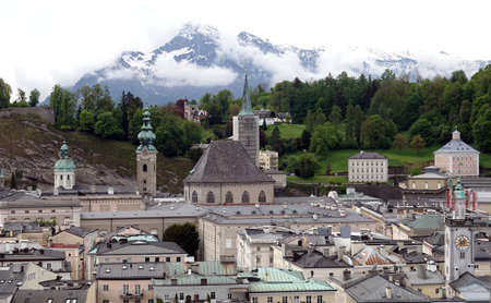 Salzburg and high snow alpine mountains at far Banco de Imagens