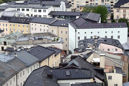 Top view of different buildings with chimneys in typical west european city