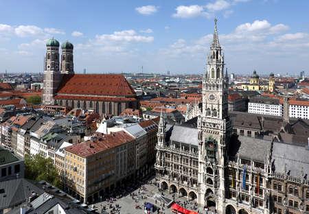 Landmarks on Marienplatz in Munich on sunny summer day above skyline