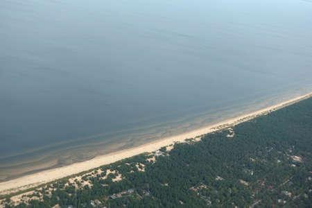 Gulf of Riga coastline with long sandy beach on Baltic sea from bird view in low tourist season