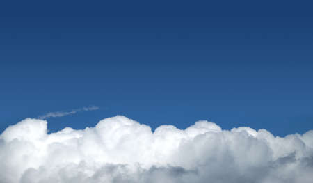 Beautiful panoramic sky landscape with white clouds on the bottom fo photo and gradient blue sky above on bright sunny day horizontal view Banco de Imagens