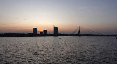 Beautiful view of cable-stayed bridge across the Daugava river in Riga forward on sunset panoramic front view
