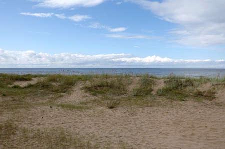 Baltic sea Empty sandy beach in Jurmala at the end of summer season photo in pastel colors Banco de Imagens