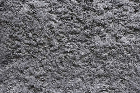 Gray volcanic harden lava as background front view