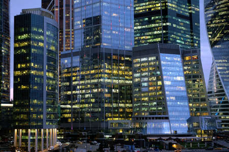 Facades of Moscow City International Business Center skyscraper buildings with panoramic windows night view