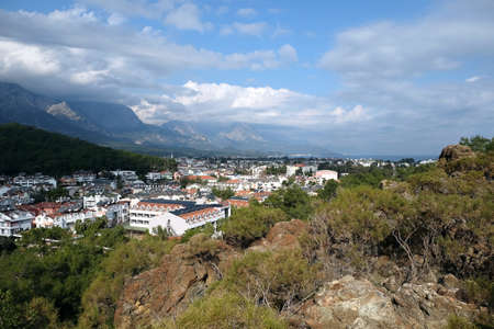 View from observing place point to valley with Kemer city in Antalya region surrounded by high mountains and calm blue Mediterranean sea on bright sunny day
