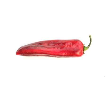 Long ripe red sweet pepper isolated on white background side view closeup