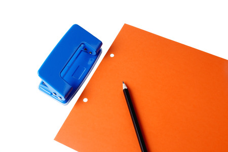 hole puncher: Hole puncher and blank paper on white background