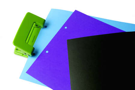 punch press: Hole puncher and blank paper on white background
