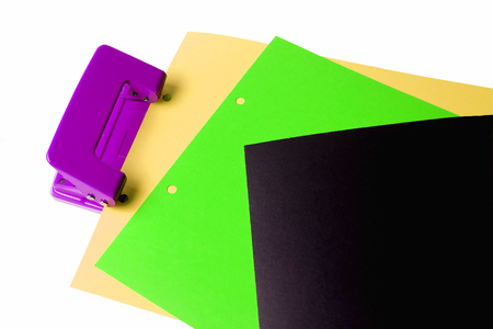 paper puncher: Hole puncher and blank paper on white background