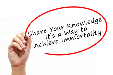 immortality: Man Hand writing Share Your Knowledge. Its a Way to Achieve Immortality with marker on transparent wipe board. Business, internet, technology concept.