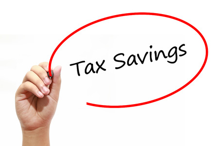 Man Hand writing Tax Savings with marker on transparent wipe board. Business, internet, technology concept.