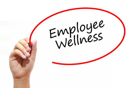 Man Hand writing Employee Wellness with marker on transparent wipe board. Business, internet, technology concept. Stock Photo