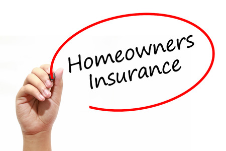 homeowners insurance: Man Hand writing Homeowners Insurance with marker on transparent wipe board. Business, internet, technology concept.