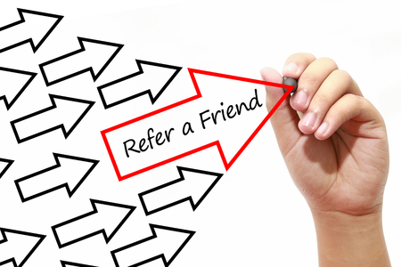 refer: Man drawing Refer a Friend arrows concept on virtual screen.Business, banking, finance and investment concept.