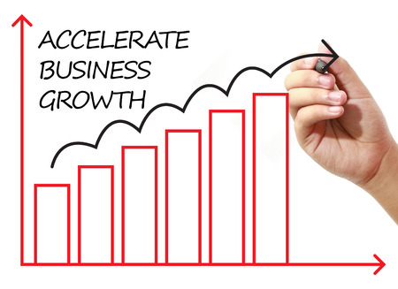 accelerate: Businessman drawing ACCELERATE BUSINESS GROWTH Graph on virtual screen. Business, banking, finance and investment concept. Stock Photo