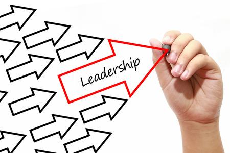 Man drawing Leadership arrows concept on virtual screen Stock Photo