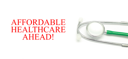 affordable: Close up Stethoscope and words AFFORDABLE HEALTHCARE AHEAD! over white background