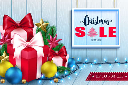 Christmas sale inside frame in wooden background banner with christmas ornaments.