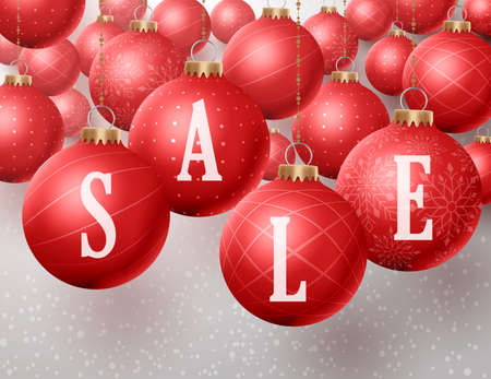Christmas sale text in christmas red balls hanging in a winter snow background for discounts and promotions. Vector illustration.