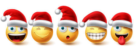 Christmas smiley vector set. Emoji xmas characters icon collection wearing santa hat isolated in white background for graphic design elements. Vector illustration. 向量圖像