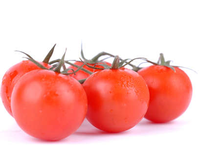 Macro shot of cherry tomatoes isolated on white background