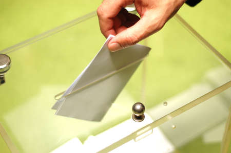 Hand putting a blank ballot inside the box, elections concept Stock Photo - 11185461