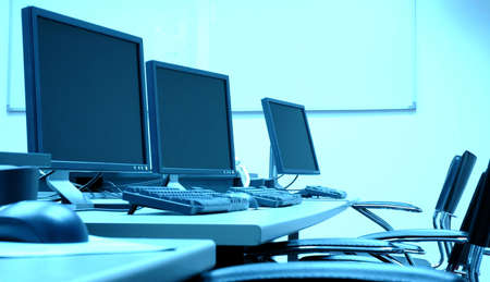 com: photo of blue screens in computer room, business concept Stock Photo
